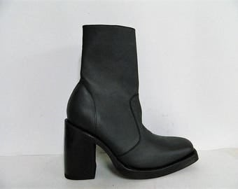 Made to order square toe  boots with double lether soles and 4 inch high heel made of embossed fake snake leather