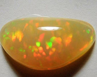 Welo opal Designer cab  Amber body with multi-color flash 3.13 ct