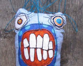 Blue grimaced handmade monster art doll