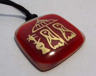 Glass pendant with divine foot print.