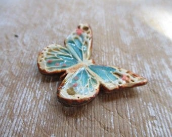 Rustic Browns Aqua and green Butterfly pendant pottery pendant