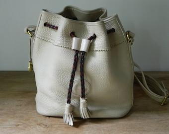 Vintage 1980's Dooney and Bourke Drawstring Tassel Bucket Bag. Beige. Bohemian. Shoulder Bag.