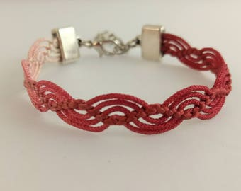Variegated pink wave bracelet created with a vintage, silk kumihimo haori tie