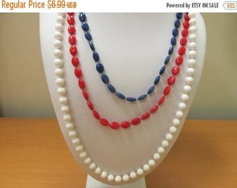 ON SALE Vintage Triple Strand Red, White and Blue Beaded Necklace Item K # 2599