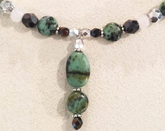 African Turquoise Puff Oval and Disk Drop Gemstone Necklace with Faceted Jade, Black Onyx & Round African Turquoise and Sparkly Czech Beads.