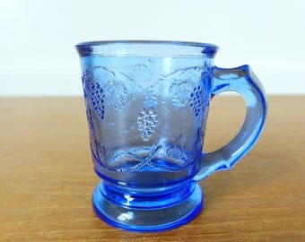 Miniature blue EAPG grapevine mug shot glass, pressed glass