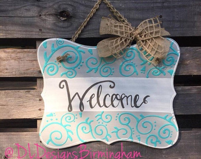 Welcome door hanger with hand lettering