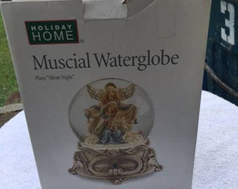 Retired Macy Musical snow globe...FREE shipping!!
