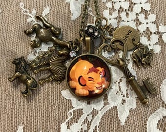 """Antique Bronze Tone, Pendant Necklace With Charms, 'The Lion King'. """"Simba""""."""
