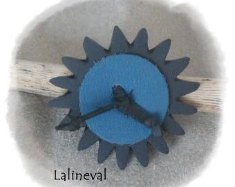 Flower ring in inner tube and blue leather
