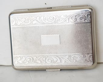 Vintage silver cigarette case with engraved flowers