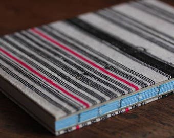 Handmade lined journal-notebook with Hmong hill-tribe fabric cover A5 size in white with black and neon stripes (NB0003)