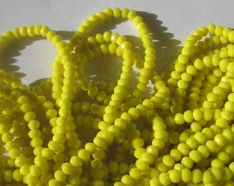 30 glass beads yellow faceted 3 to 4 mm approximately (90)