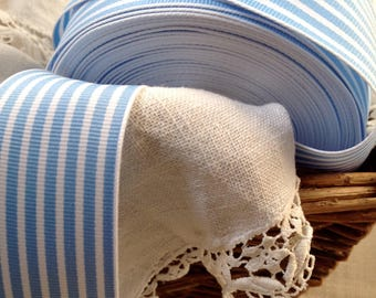 30 yard roll of warm blue and white striped grosgrain ribbon