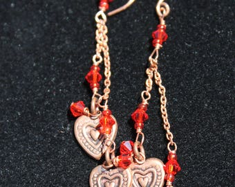 Copper hearts with red crystals long earrings