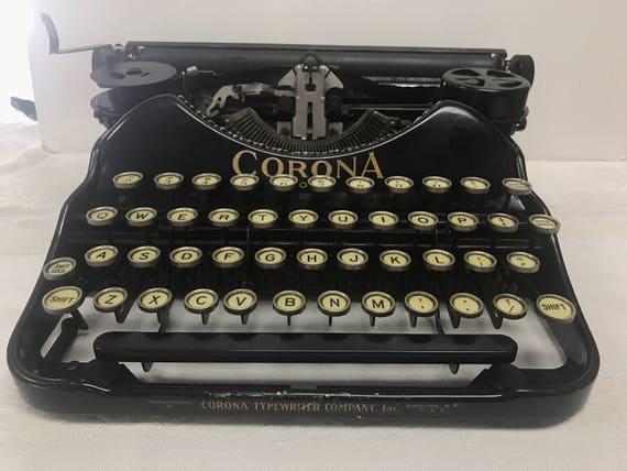 Corona four portable typewriter working with case