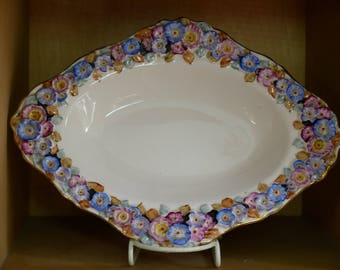 Vintage Oval Dish with Embossed Flower Design by Tuscan China