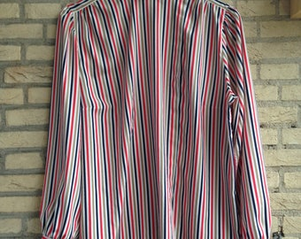 Vintage blouse with vertical stripes.