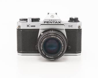 Pentax K1000  SE (Special Edition) 35mm film camera with 50mm F1.4 Prime Lens - great working student camera with 1 roll film Ready to shoot