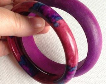 Bangles - pair of vintage purple bangles one plastic one stained wood