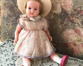 A beautiful vintage celluloid doll