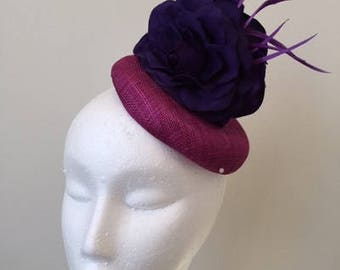 Gorgeous purple button base fascinator with dark purple flowers and feathers!