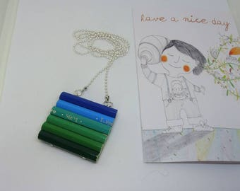 Wooden long necklace with colored pencils in green, light blue and blue
