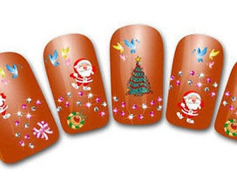 Nail art stickers etsy one sheet of christmas nail art stickers approx 30 decals santa claus stickers prinsesfo Images