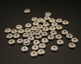 100 antique silver separator beads. (ref:2965).