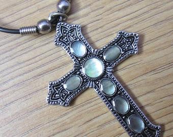 Iridescent Paua shell Cross Pendant Necklace on a Black Cord.