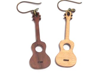 Walnut and curly maple miniature ukuleles with niobium ear-wires