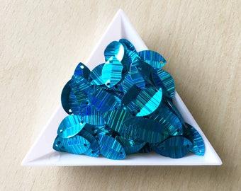 Turquoise leaf features 14 mm iridescent sequin in bulk