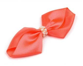 Beads and orange satin ribbon bow