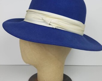 Vintage 1970s blue fedora hat with white band