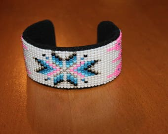 Ethnic handwoven shades pink, blue and white beaded bracelet