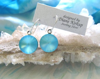 These earrings are a shimmering delight of color.  They are etherial - they are like the ocean.  Presented on sterling silver ear findings