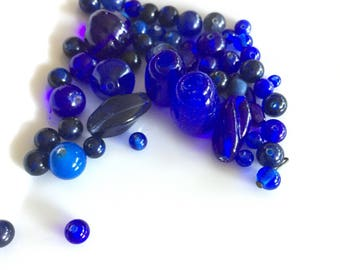 Mixed lot of deep blue glass beads some peking glass blue swirl bead