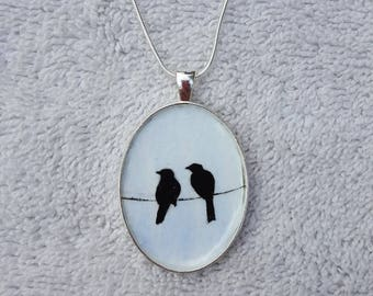 2 birds on a wire