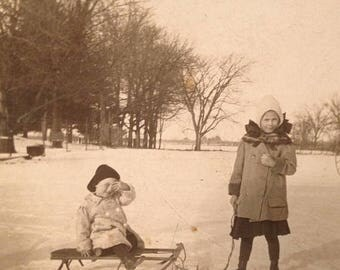 ON SALE Old Vintage Antique RPPC Real Photo Postcard Sisters Kids Children Sled Snow carriage
