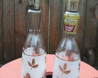 Mid century Arrow Brandy Bottles.Gold leaves on bottles, bar ware, bar decor.