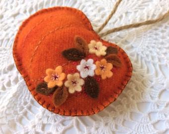 orange felt pumpkin ornament with hand embroidery