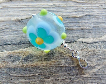 Turquoise lampwork glass pendant with sterling silver bail.