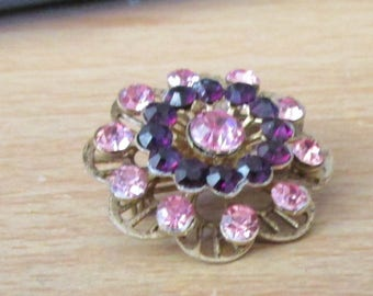 """vintage goldtone floral brooch with pink/ruby stones 1.25""""across very good condition"""