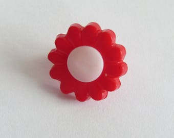 Red and white flower shaped button