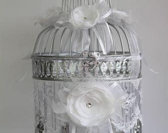 Bird cage wedding lace flowers and ribbons with large urn