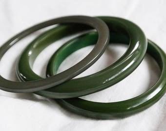 Bakelite bangles in dark green