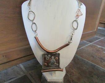 Meditational/Spirital sterling silver image on copper, fine silver and sterling silver chain