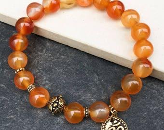 Women's carnelian OM charm bracelet, boho bracelet, yoga mala beaded bracelet, wrist mala stretch bracelet, gift for woman, Wildcoastjewels