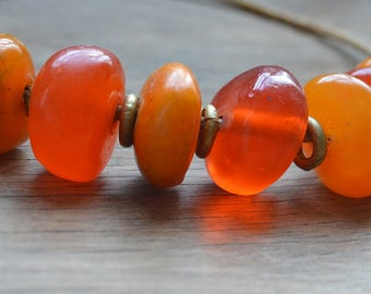 African amber trade bead necklace with Asante brass