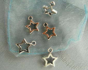 Lot 5 star pendants-like silver metal